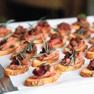 Peppered Beef Tenderloin Crostini with Caramelized Onions