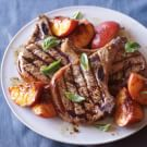 Grilled Pork Chops with Caramelized Peaches and Basil