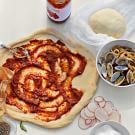 Potato and Clam Pizza with Pancetta and Calabrian Chile Sauce