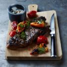 Grilled New York Strip Steak with Tomatoes and Peppers