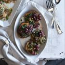 Roasted Acorn Squash with Wild Rice and Grapes