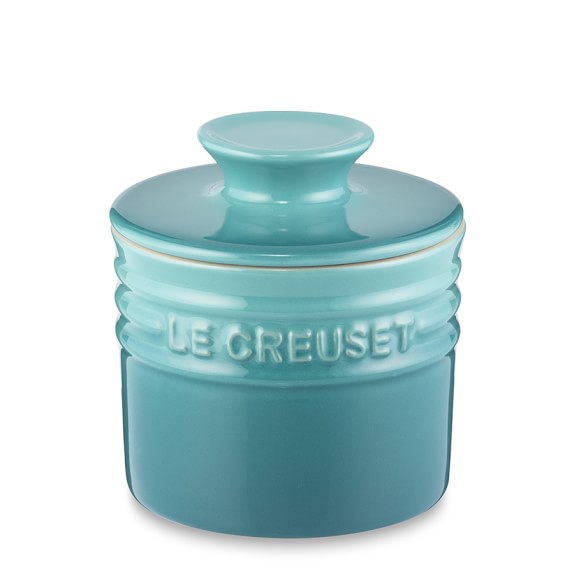 The Le Creuset butter crock is so easy to use. Pour a little water in the base (left), smoosh butter into the lid (right), and then fit the two together.