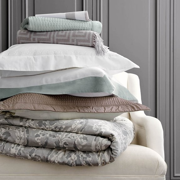 Bed Linen. Bed linen in organic cotton, woven ticking stripe cotton and supple, washed linen/cotton.
